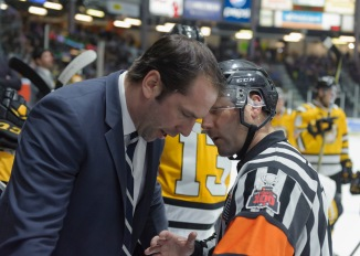 Associate Coach David Legwand chats with a referee during a stoppage in play.