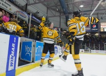 Sarnia celebrates a 4-3 shooutout win, the Sing's 45th victory of the season