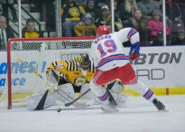 Justin Fazio stops Kitchener's Logan Brown during the shootout
