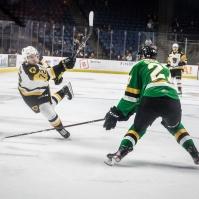 Brady Johnson shoots the puck through Kirill Steklov