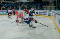 Cole Perfetti scoops up the loose puck in behind the Guelph goal. (Steven Frank Imagery)