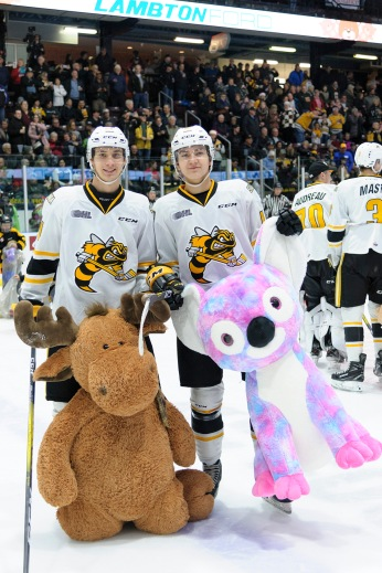 The Sting pose with some stuffed animals after the Teddy Bear Toss goal. (Metcalfe Photography)