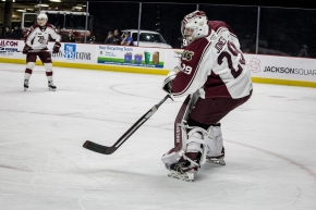 Hunter Jones comes out of the net to play the puck.