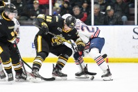 Nolan Burke ties up a faceoff in the offensive zone (Metcalfe Photography)